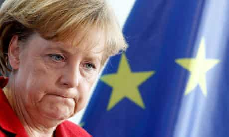 German Chancellor Merkel reacts during news conference in Berlin