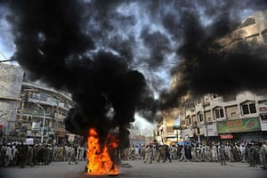 Israel protests: Pakistani demonstrators burn tyres during a protest in Peshawar