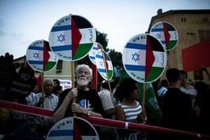 Israel protests: Israeli left-wing protesters demonstrate against Israel's raid