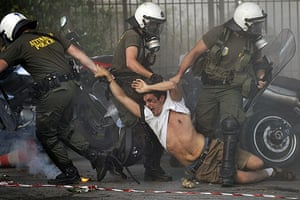 Israel protests: Police drag a protester during a pro-Palestine demonstration in Athens