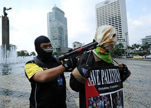 Israel protests: Indonesian students act uring a protest, in Jakarta, Indonesia