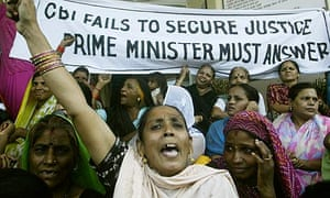 Victims of the Bhopal gas disaster attend a demonstration in Bhopal