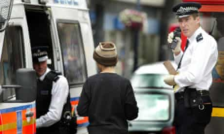 Police stop and search a suspect in London