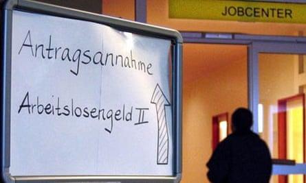 A unidentified man enters a public labour office in Berlin