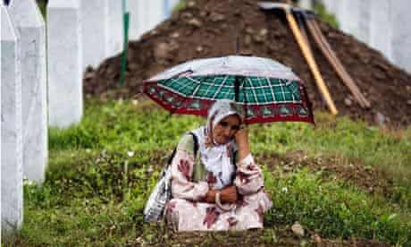 A Muslim woman mourns during the last year funeral ofvictims of 1995 Srebrenica massacre