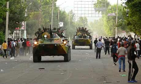 Servicemen drive armoured vehicles in the city of Osh in southern Kyrgyzstan