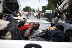 24 hours in pictures: Port-au-Prince, Haiti: An injured protester