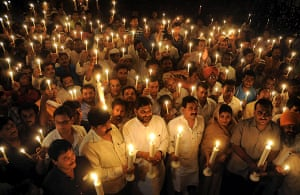 24 hours in pictures: Bhopal, India: People take part in a vigil