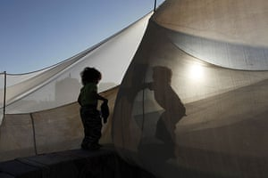 24 hours in pictures: Palestinian children play with the tent which houses their family