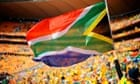 Young South African fan waves a flag ahead of the opening ceremony
