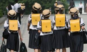 Children walk on way back from school in Tokyo