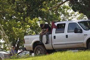 Arkansas floods: An unidentified man hangs his head in frustration