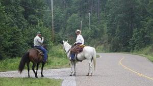 Arkansas floods: Volunteers on horseback survey the damage before looking for survivors