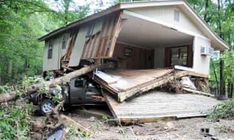 Debris around cabins on Little Missouri River after a flash flood in Langley, Arkansas.
