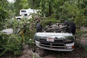 Arkansas floods: An overturned van and a damaged vehicle near the Little Missouri river