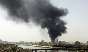 Smoke billows from the scene of one of five explosions that rocked the Iraqi capital Baghdad.