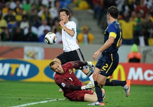 World Cup Day 3: Mesut Ozil chips the ball over the the Australia goalkeeper Mark Schwarzer