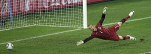 World Cup Day 3: Thomas Mueller puts the ball past Mark Schwarzer to score Germany's third