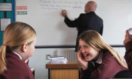 Two schoolgirls having fun