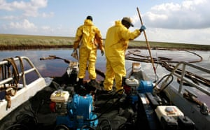 BP oil spill: Deepwater Horizon oil spill: Workers use pumps to suck up pockets of oil