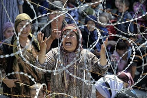 Uzbek refugees: A woman weeps as she stands in line in no-man's-land