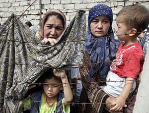 Uzbek refugees: A refugee waits at the Kyrgyz-Uzbek border outside the village of Suratash