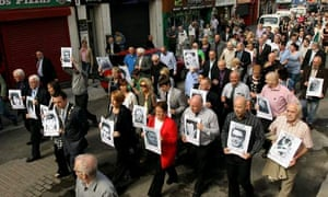 Families of the victims of Bloody Sunday march to the Guildhall in Derry to read Saville report