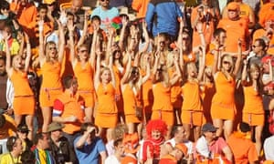 women in orange dresses at the Holland v Denmark World Cup game