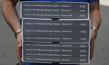 A person carries a copy of the Saville Inquiry report into Bloody Sunday