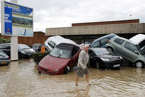 Flooding in France: A man walks past damaged cars in Draguignan