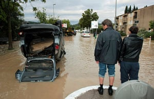 Flooding in France: Draguignan: People look at an upturned car
