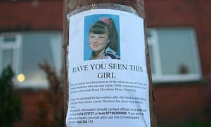 Local residents put up a poster of Shannon Matthews in Leeds