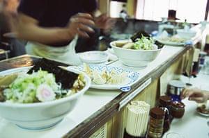 Ramen noodles: Ramen and dumplings on the bar at a restaurant in Shinjuku, Tokyo, Japan