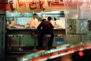 Ramen noodles: A man sits at a Ramen noodle restaurant in Tokyo Japan