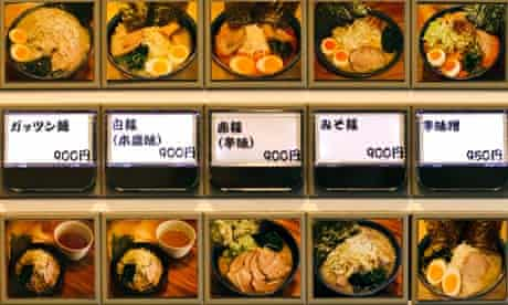 An automated ticket dispenser at a ramen noodle restaurant in Tokyo, Japan