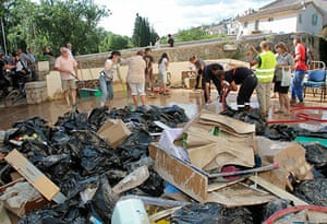 France Floods: Trans-en-Provence: People clean up a terrace in the aftermath of flooding