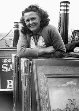 Longden's Canals: A woman smiles from the door of her canal boat