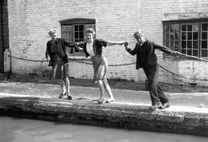 Longden's Canals: Three young adults pulling on a tow-rope