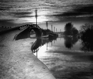 Longden's Canals: A stark landscape showing a snow covered foot-bridge