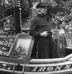 Longden's Canals: An old man in a captain's hat stands at the helm of his boat