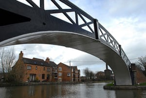 Longden's Canals: A wrought iron bridge frames a view of a new canal-side building