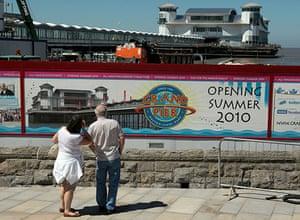 Grand Pier: People stop to read a bill board