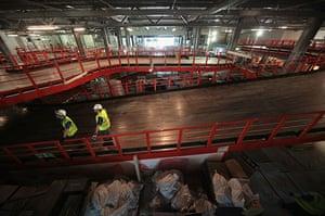 Grand Pier: Construction workers inspect the indoor go-kart circuit