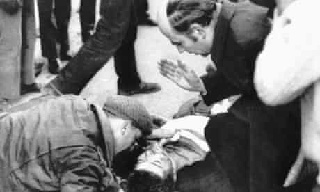 Edward Daly, gives last rites to a boy injured in the Bloody Sunday shootings