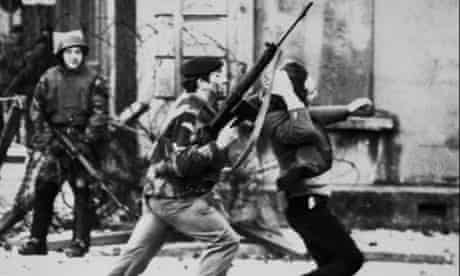 A British soldier drags a Catholic protester durin