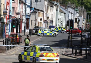 Cumbria shootings: Officers attend the scene on Duke Street in Whitehaven, where Darren Rewcastle was shot dead at 10:30am