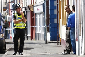 Cumbria shootings: A police officer near the scene of the shooting on Duke Street in Whitehaven