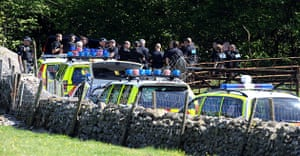 Whitehaven shootings: Police officers stand in a wooded area close to Derrick Bird's car