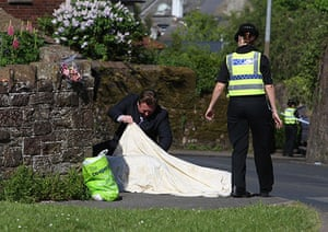 Whitehaven shootings: Police look under a blanket covering a body in Egremont