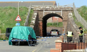 Whitehaven shootings: A car left covered next to the small archway taking the country lane